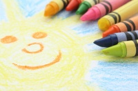 Childlike drawing of the sun and sky with crayons