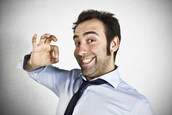 Friendly young businessman showing ok sign